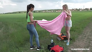 Outdoor swishy toy insertion play nearby Alecia Fox and Angela Allison